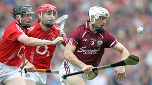 Galway's Andy Smith looks to run clear of two Cork players