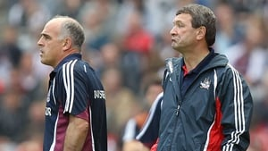 Managers Anthony Cunningham of Galway and Jimmy Barry-Murphy Cork look on as their charges do battle