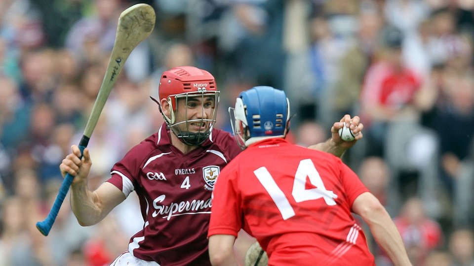 Fergal Moore is confronted by Cork's Luke O'Farrell