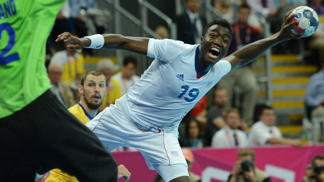 France's rightwing Luc Abalo attempts to shoot past Sweden's goalkeeper Johan Sjostrand during the Men's Handball final