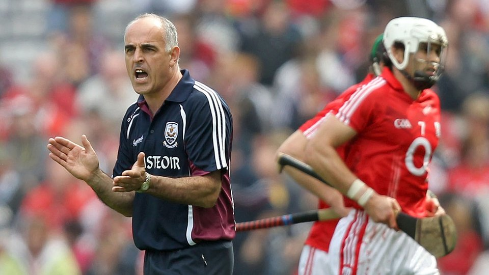 Anthony Cunningham offers encouragement to his Galway troops as Cork make their way off at half time