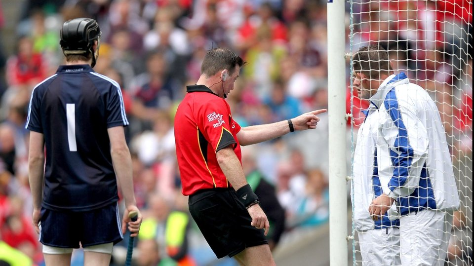 Referee David Hughes consults his umpires regarding a late Clare point that was signalled wide