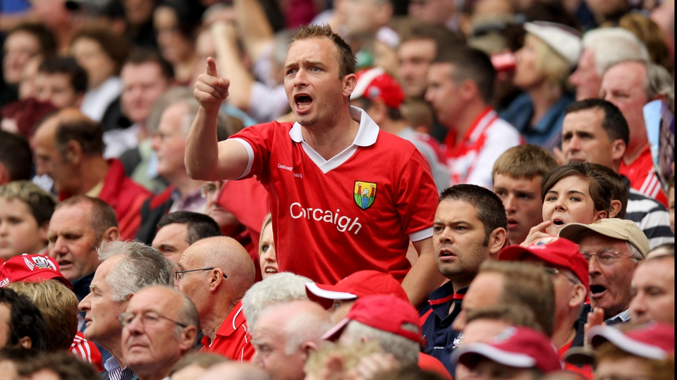 A Cork supporter makes his view known
