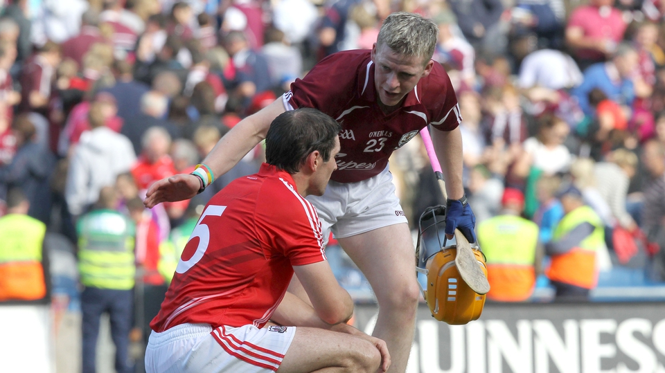 Galway's Davy Glennon consoles Tom Kenny of Cork