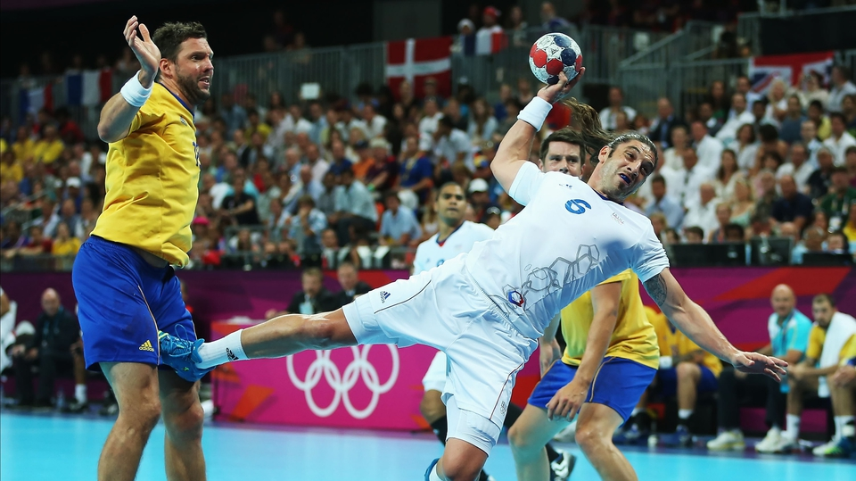 Bertrand Gille of France shoots and scores past Tobias Karlsson of Sweden during the men's handball gold medal match