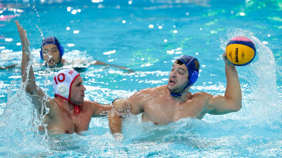 Filip Filipovic of Serbia is challenged by Boris Zlokovic of Montenegro during the men's bronze medal water polo match