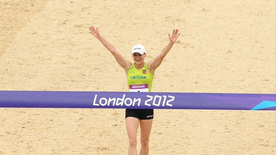 Laura Asadauskaite of Lithuania crosses the line in first place during the women's modern pentathlon