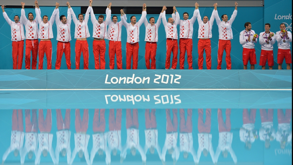 Croatia's gold medalists pose during the podium ceremony for the men's water polo match