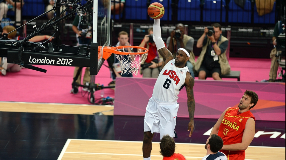 US forward LeBron James scores during the men's gold medal basketball game between USA and Spain
