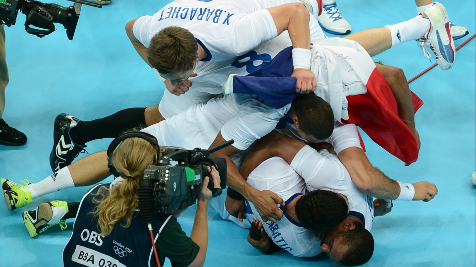 France's players celebrate after they won the gold medal