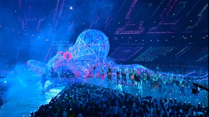 British DJ and musician Fatboy Slim performs on an inflatable octopus