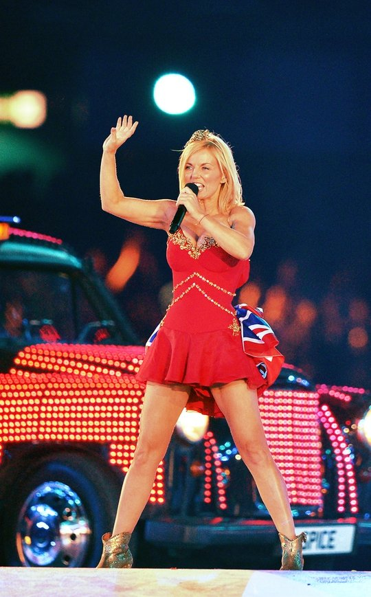 We were disappointed Geri didn't rock her famous Union Jack dress, especially since she just designed a dress with the flag on it for Next. However she looked great in this this Suzanne Neville dress with flag detail