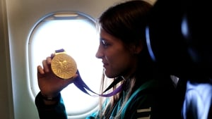 A quiet moment for Katie Taylor as she flies home from London 2012