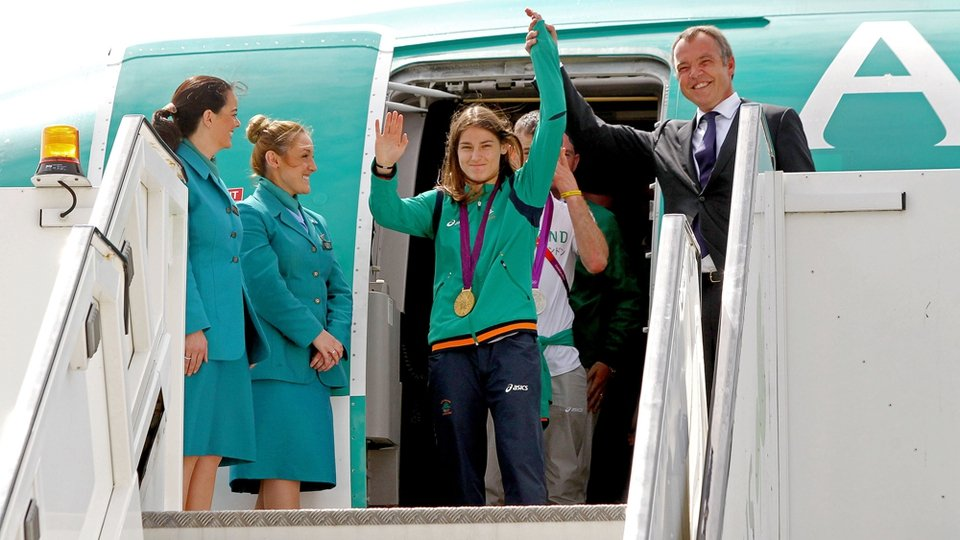 Katie Taylor emerged first from the Team Ireland plane