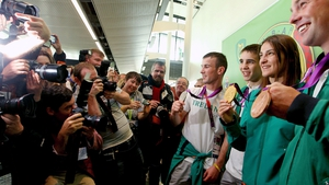 The press swarmed around Ireland's medal winners at Dublin Airport