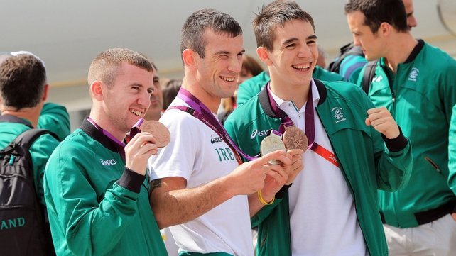 Barnes, Nevin and Conlan show off their medals at Dublin Airport