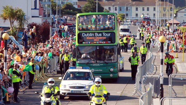 Open-top bus carrying Katie Taylor makes its way through Bray