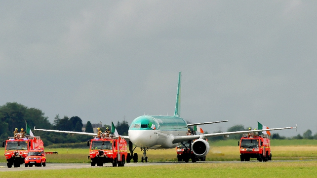 The plane carrying Team Ireland was escorted by the airport fire service on the runway at Dublin Airport