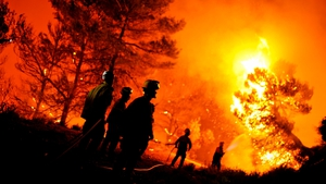 Firefighters of Alcoy and Elda try to extinguish a fire in Torre de Macanes near Alicante yesterday