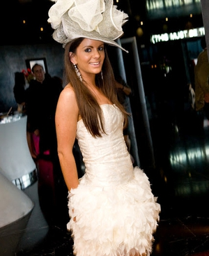 Nicola McLaughlin wearing dress by designer Una Rodden and hat by Michael Gerrard Millinery