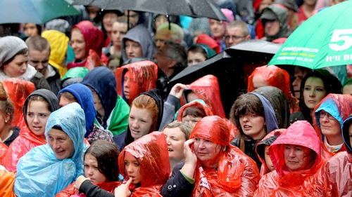 Despite bad weather, crowds gathered outside the Mansion House