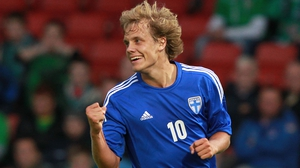 Teemu Pukki of Finland celebrates following a mix-up by the home defence at Windsor Park