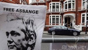 Police stand guard outside the Ecuadorian Embassy