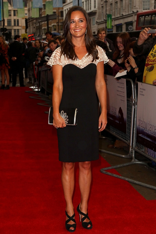 Pippa Middleton turned up to a London premiere this week ten shades darker than her skin tone, with four times the necessary amount of eyeliner, in a fairly blah Alice by Temperley dress
