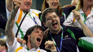 Gabriel Shelly celebrates his Bronze medal win in the Boccia Mixed Individual - BC1 with team-mate Padraic Moran