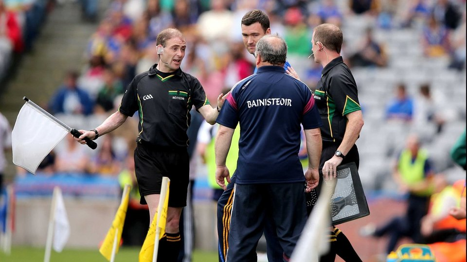 Sideline officals separate Galway manager Matt Murphy and Tipperary boss Willam Maher