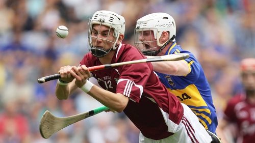Tipperary's Jack Peters and Jason Flynn of Galway clash during the minor semi-final