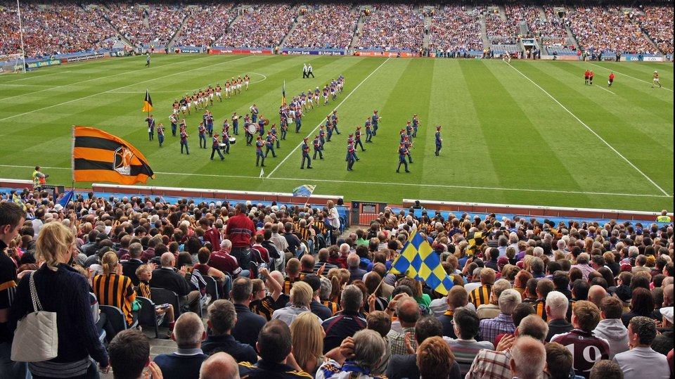 Tipperary and Kilkenny players walk behind the band during the pre-match parade