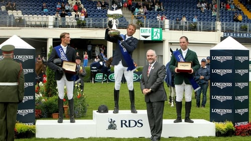 Riders Carsten-Otto Nagel (c), Kevin Staut (l) and Cian O'Connor (r) on the podium after the Longines Grand Prix