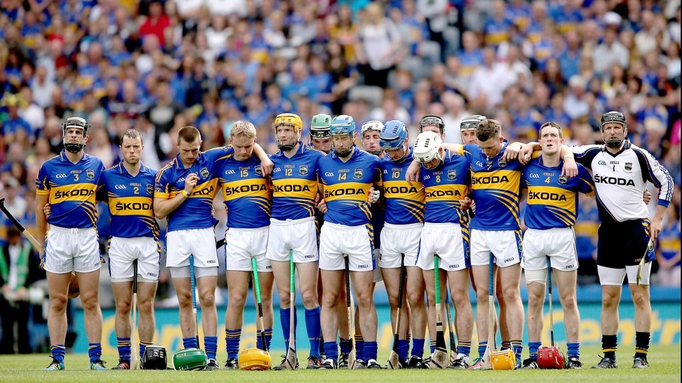 Tipperary players observe a minute's silence in memory of the late brother of  John O'Brien (14)