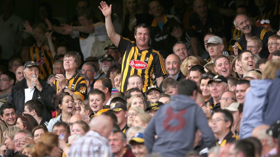Kilkenny fans wave to Tipperary fans as the leave