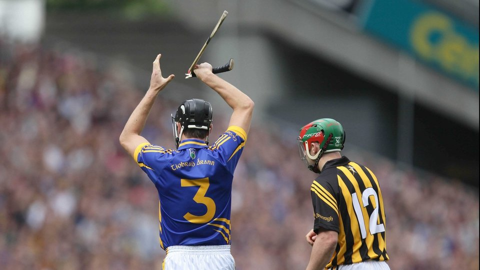 Tipperary's Paul Curran signals for a new hurley