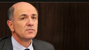 Italian Industry Minister Corrado Passera critical over German reluctance to agree on bond action