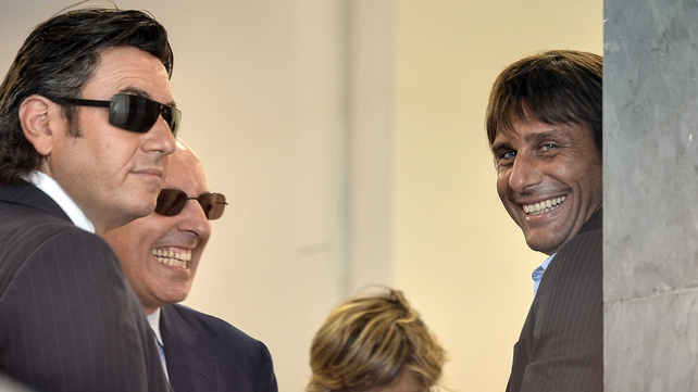 Juventus coach Antonio Conte (r) stands next to his lawyer Antonio De Renzis before his appeal hearing before the disciplinary commission