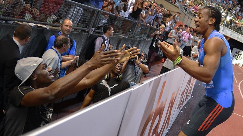 Usain Bolt congratulates Yohan Blake on his 100m victory