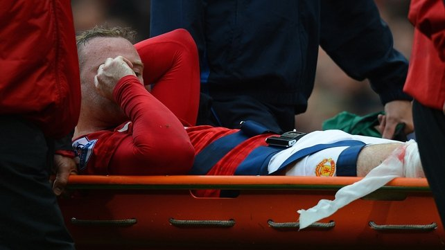 Rooney being stretchered off the Old Trafford pitch on 25 August