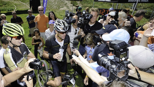 Lance Armstrong speaks to the media in Aspen, Colorado
