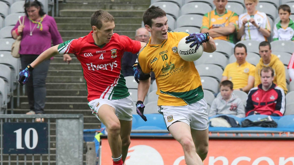 Michael Plunkett of Mayo attempts to dispossess Cillian O'Sullivan of Meath