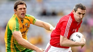 Donegal's Ryan Bradley chases down Cork captain Graham Canty