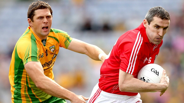 Donegal's Ryan Bradley chases Graham Canty of Cork