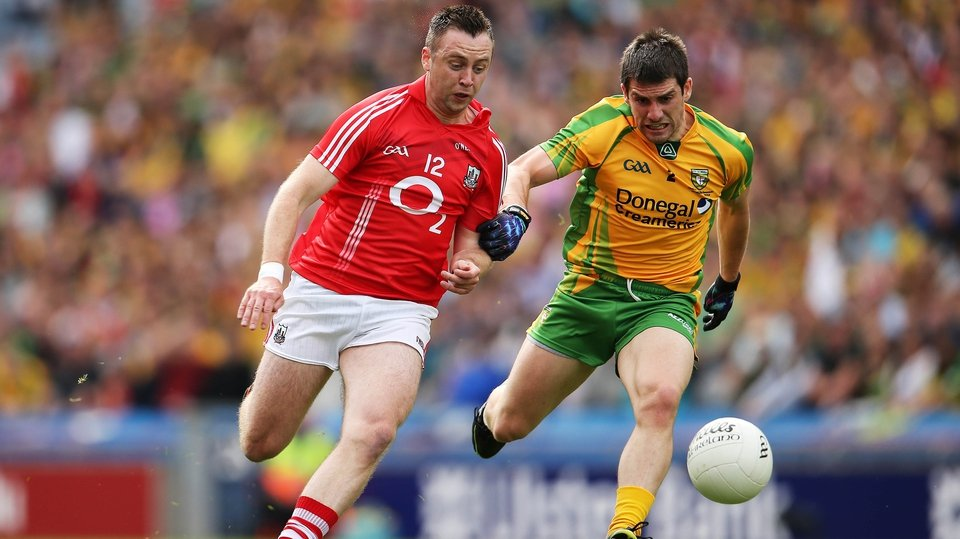 Cork's Paul Kerrigan and Paddy McGrath of Donegal tussle for possession