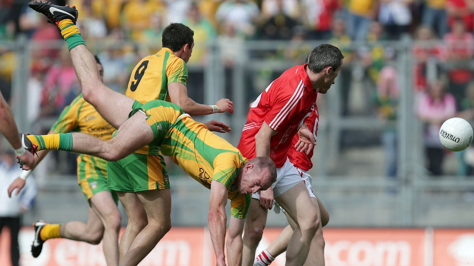Donegal's Neil Gallagher takes a hard fall
