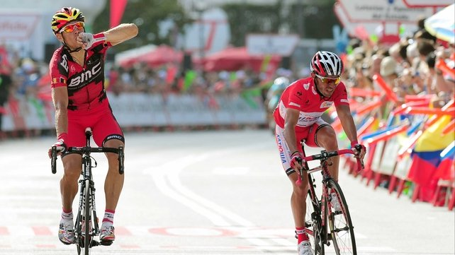 Philippe Gilbert (l) salutes after victory in the ninth stage of Vuelta a Espana, with Joaquim Rodriguez second