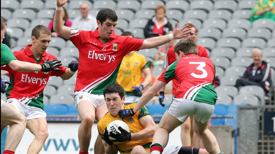 Fiachra Ward of Meath is surrounded by a posse of Mayo players