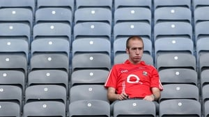 A dejected Cork fan is left to mull over his side's loss