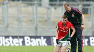 Sean Moran of Mayo is consoled after his side's 2-11 to 1-12 defeat